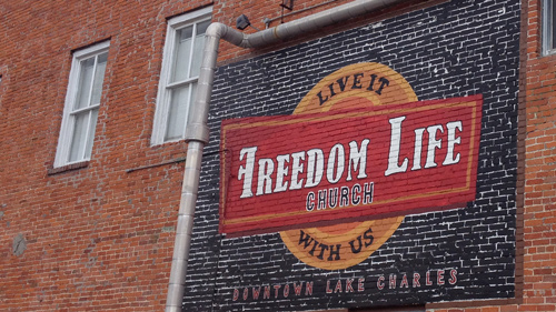 Freedom Life Church building exterior with logo
